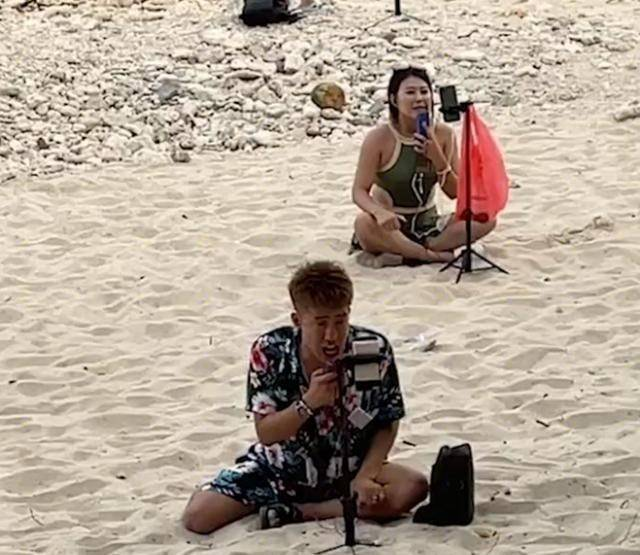 女子去三亚发现海滩大量网红直播卖艺 举手机拍下奇葩一幕引瞩目